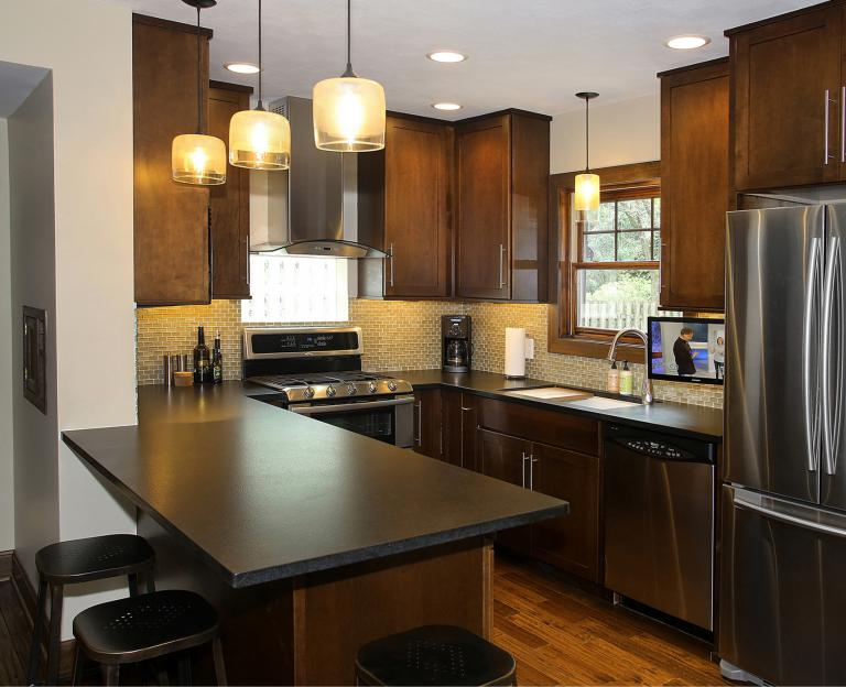 "U-Shaped kitchen with ""leather finish"" granite counters"